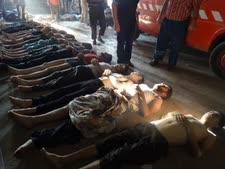 גופות קרבנות אחת המתקפות הכימיות [צילום: AP]