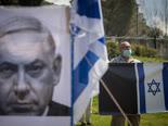 הפגנה מול הכנסת [צילום: יונתן זינדל/פלאש 90]