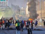 מהומות בעיר נג'ף [צילום: ענמר חלילי, AP]