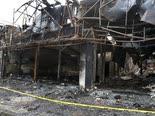 בניין שהוצת בעיר שחריאר [צילום: וחיד סאלמי, AP]