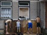מהגרים מעירק בעיירה מדרום לווילנה [צילום: מידאוגס קובליס, AP]