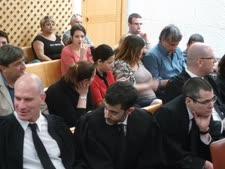בלכר (מימין) וברטל (משמאל) במשפט הולילנד