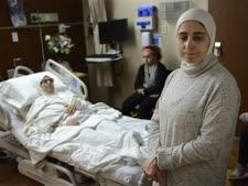 """פליטה סורית שלא הורשתה להיכנס לארה""""ב [צילום: פול ביטי, AP]"""