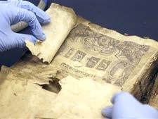 """ספרי הקודש המשוקמים בארה""""ב [צילום: אלכס ברנדון/AP]"""