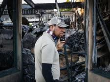 מניאפוליס: חנות שהוצתה [צילום: ג'ון מינצ'ילו, AP]
