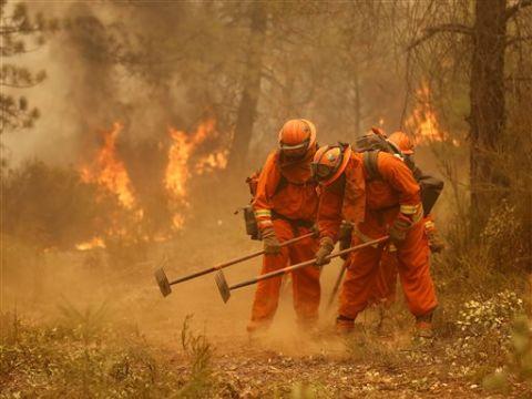 באש ובמים [צילום: AP/Rich Pedroncelli]