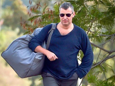 סטס מיסז'ניקוב עם כניסתו לכלא  [צילום: באסל עווידאת/פלאש 90]